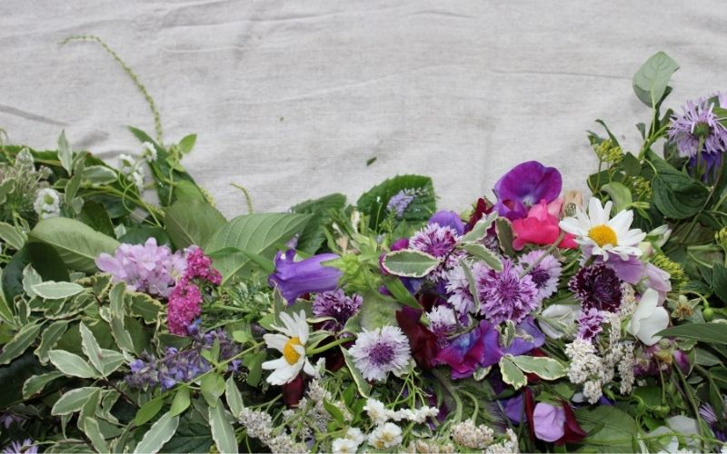 Deconstructed wreath made up of lots of posies for family to take home